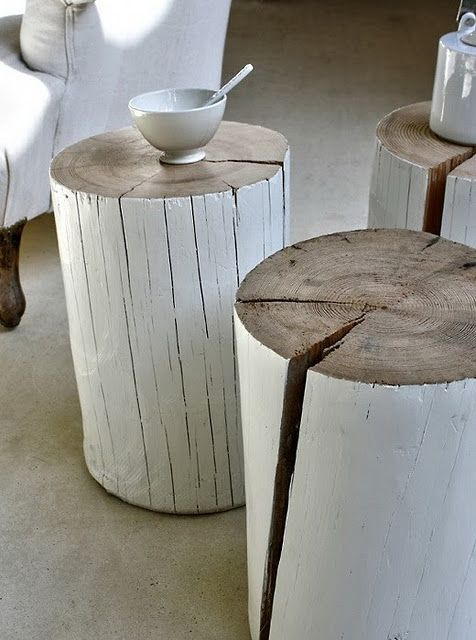 Cute and simple way to use tree stumps - painted stools.