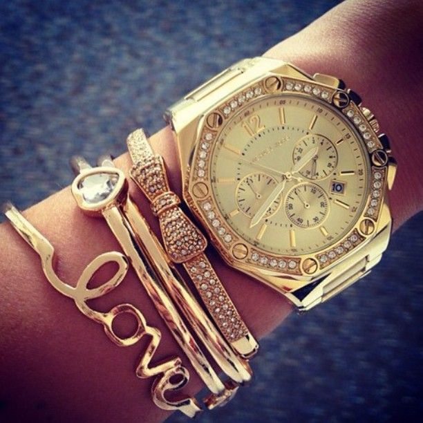 watch and bracelets in gold. I like the idea but maybe with a different take