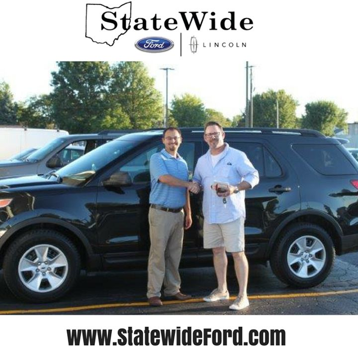 Christopher Booher taking delivery of his new Ford Explorer from Logan Rupert. Thank you for your business!