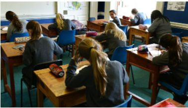 School: This is a picture of students in a classroom in Ireland learning social studies. Not all of the subjects in Ireland are the same as some that we have in America their are even more they teach in their normal classes. Ireland has  also taught Irish, Latin, Ancient Greek, Classical Studies, Hebrew Studies, German, Italian, Home Economics,  Materials Technology, Metalwork, Technical Graphics, Typewriting, Business Studies, Civic, Social and Political Education, and Religious Education.