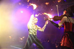 The Liqueur Flambe Show Violins, Circus, Tango & Fire!  A mesmerising blend of Strings on Fire's most spectacular circus stunts and flames, and of course, live violin playing.  This dynamic variety show is full of contrasts and unexpected delights that will keep your audience absolutely enthralled from start to finish.