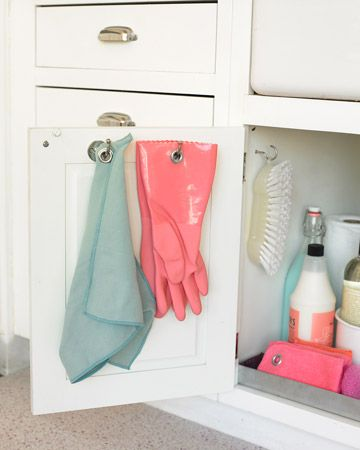 Don't let kitchen rags and dishwashing gloves clutter the sink area. Instead, hang them from hooks screwed to the inside of a cabinet door, where the items can stay out of sight as they dry.    Read more at Marthastewart.com: Easy Organizing Tips – Martha Stewart
