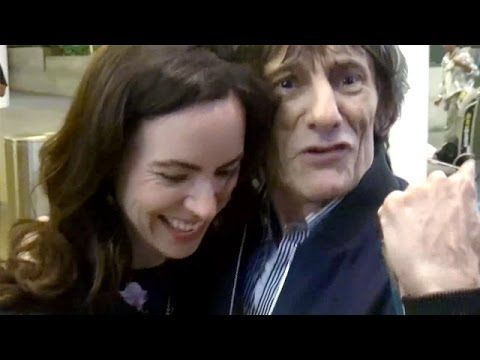 EXCLUSIVE - Rolling Stones' Ronnie Wood And Wife Sally Swarmed By Fans At LAX
