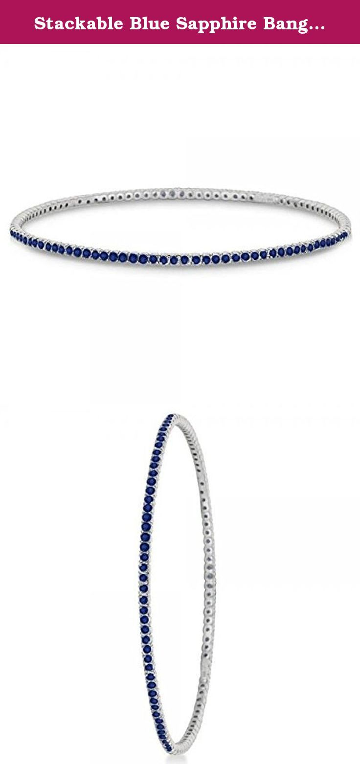 Stackable Blue Sapphire Bangle Eternity Bracelet 14k White Gold 2.60ct. This unique and contemporary piece of fine jewelry showcases 111 brilliant cut round blue sapphires set in a prong setting that go all the way around a bangle bracelet that defines luxury. This eternity slip-on stack bracelet features shiny eye clean clarity with a modern design that's wonderfully crafted in 14kt white gold. Wear it alone or mix and match with our other stackable bangles.