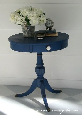 """IKEA makeover? """"a few coats of Annie Sloan chalk paint in Napoleonic Blue. To be honest...I wasn't too happy with my paint choice...the whole thing looked very dull and lifeless. But after some distressing, a new knob, and a coat of clear wax I was completely won over. The soft sheen of the wax made all the difference."""