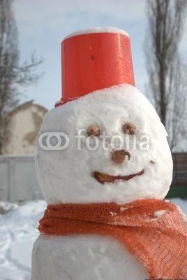 Snow man's face during the winter holidays