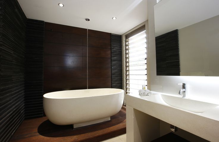 Freestanding stone bath that fills up from the ceiling.  How cool!