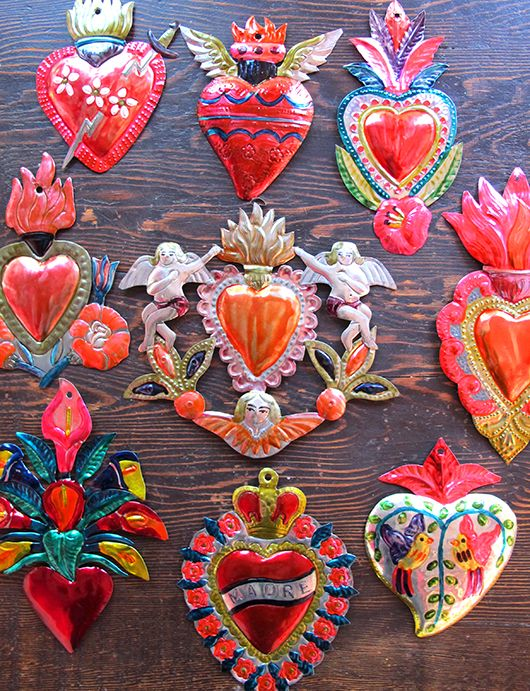 Corazones sagrados. Beautiful handmade tin hearts from Mexico. I really like the colors!