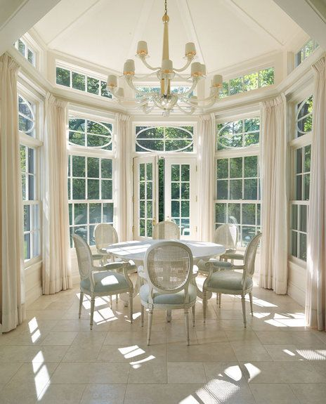 Sunroom cum dining room - gorgeous windows, door and transom - beautiful dining room | Huth Architects