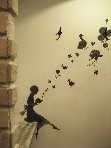 I really like this wall decal! It's like the book holds all sorts of different treasures and beautiful...