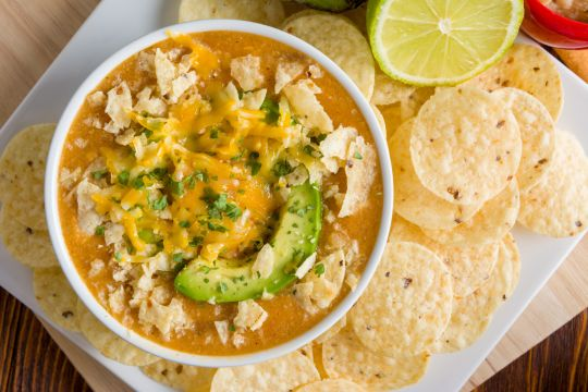 Slow Cooker Enchilada Soup is the perfect comfort food without the guilt.