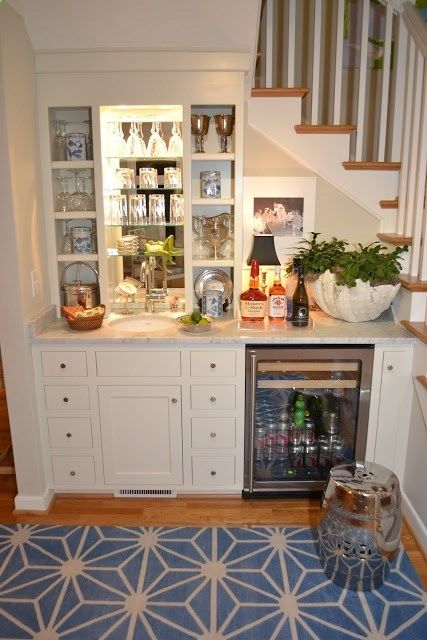 A bar under the stairs. Great for a basement!