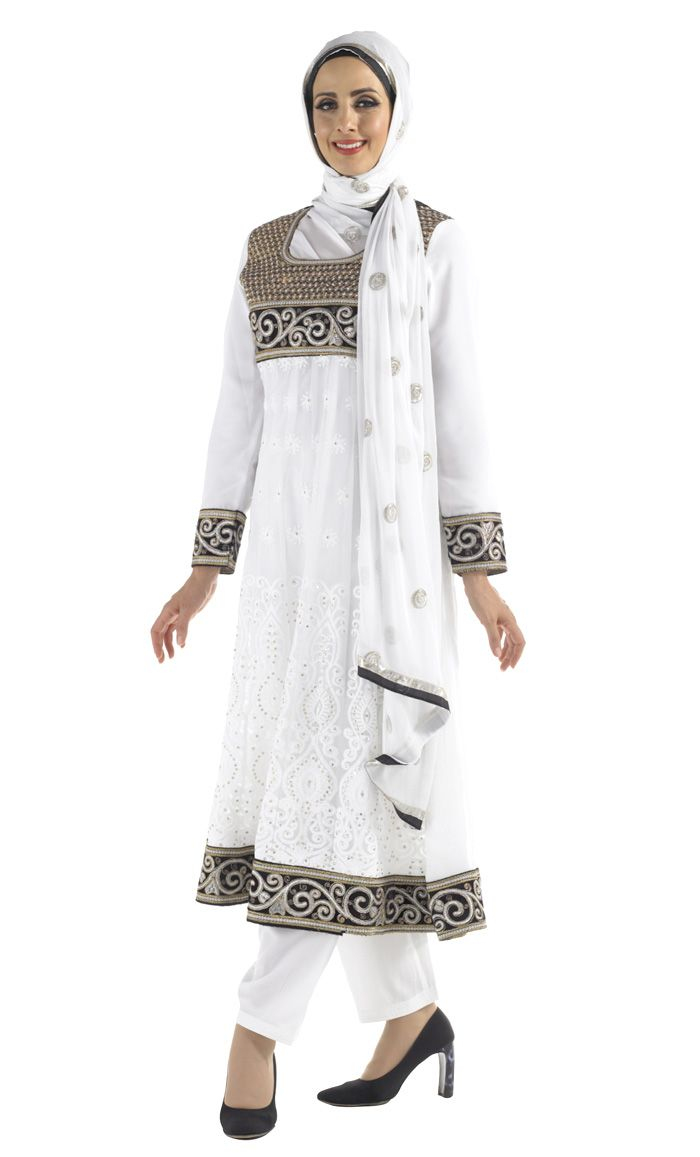 White & Black Shalwar Kameez This Stunning Shalwar Kameez is great for any occasion: Weddings, Eid, Diwali! 3 Piece Shalwar Kameez Includes: Scarf, dress and Pants