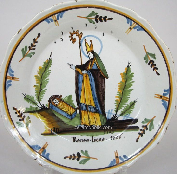 St. Renee~Plate from Nevers (dated 1806 & inscribed Rene Lions) with the figure of Saint Maurille (Bishop of Angers) that regenerates a dead child by baptizing him. Saint Renee is the child that receives a re-born life. The theme of this plate is extremely popular due to Renee d'Anjou, King of Naples and Sicily that spread this legend in the 15th century – Private Collection France.
