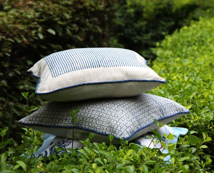 Indian Textile Company, The Anhad Shop creates fresh home textiles with traditional Indian motifs. This indigo collection of cushion covers in khadi silk fabric is decorated with softly worn hand block geometric prints.