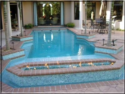We consulted with Blue Haven Pools on this beautiful backyard and though the pictures don't show our FireGlass in the fire pits still turned out amazing! Description from pdgosystem.com. I searched for this on bing.com/images