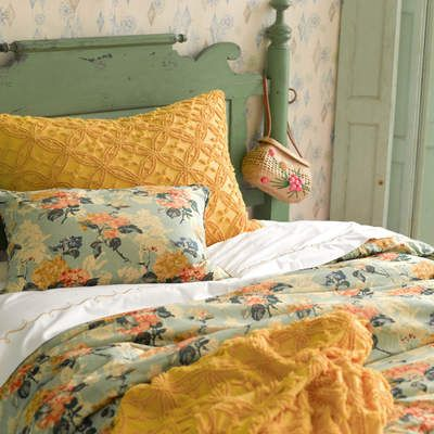 Vintage never looked so contemporary cool. Layer embroidered sheets with a floral duvet and sham, plus a beautifully textured throw.