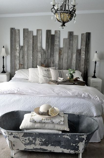 reclaimed wooden headboard, carpentry woodworking, design d cor, A vintage cowboy tub at the end of the bed provides storage for extra pillows and quilts