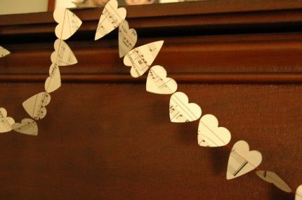 sewing a string of paper hearts <3