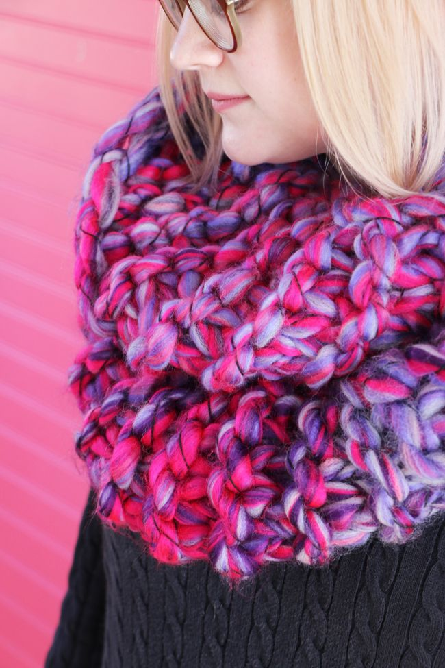 This cozy knit cowl by Blitsy is the perfect project for beginning knitters! Make it with 3 skeins of Lion Brand Quickie (pictured in fruity) and size 50 knitting needles.