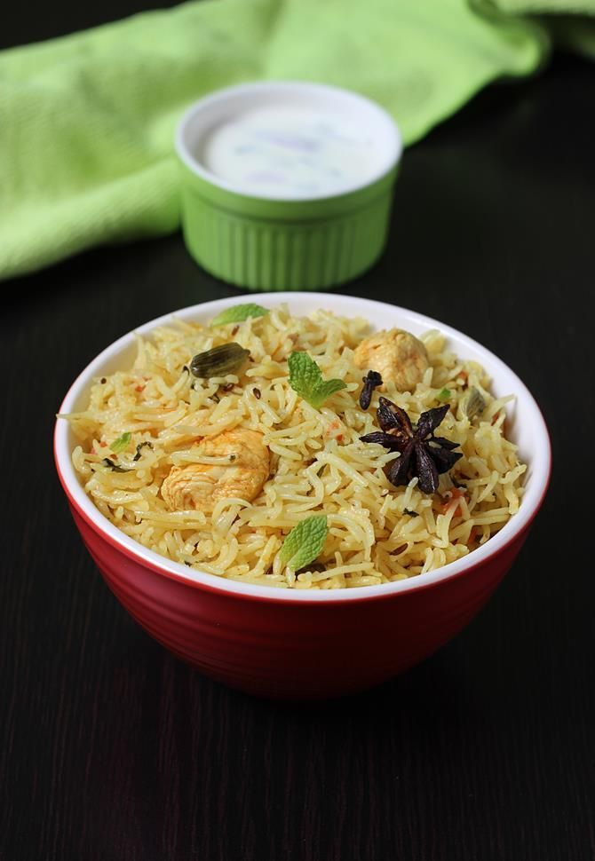chicken pulao recipe - learn to make delicious, spicy and the best chicken pulao recipe with step by step pictures. Can be accompanied with onion raita.