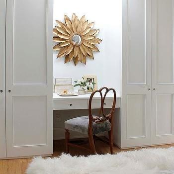 Gold Sunburst Mirror Over Built In Desk