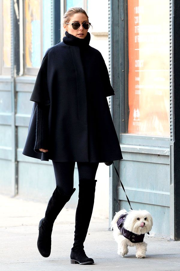 Here's Olivia as a caped crusader against the New York City cold while out with Mr. Butler.