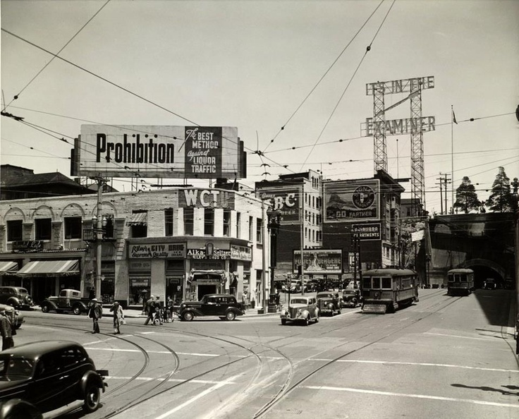 """Temple & Broadway: 1930's Los Angeles.....Note the """"Prohibition"""" sign. The amendment prohibiting liquor lasted from 1919 until 1933. The sign was on the Women's Christian Temperance Building. The WCTU was a principal backer of Prohibition. The building was dedicated in 1888. The top floors were removed after being damaged in the '33 quake (originally 4 or 5 stories)."""