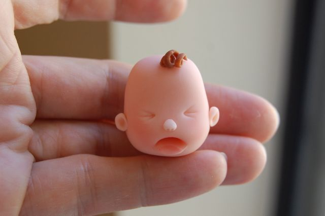 A Step-by-Step Tutorial for Fondant Baby Faces. Three different cute faces.
