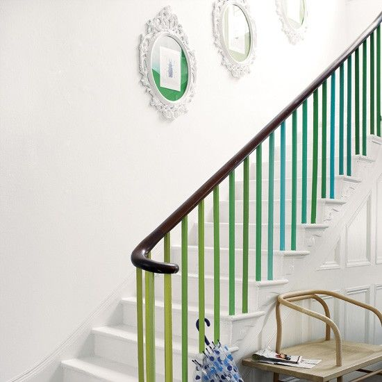 A spectrum of colours works brilliantly running along banister spindles in an all-white hallway.