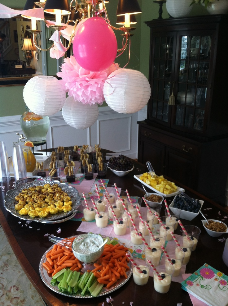 Baby girl shower brunch with mini waffles and syrup, yogurt bar and mini quiche