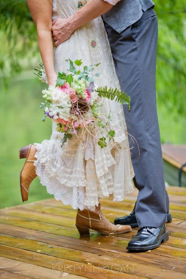 Rustic Wedding Inspiration, bride in cowboy boots with wildflower bouquet.