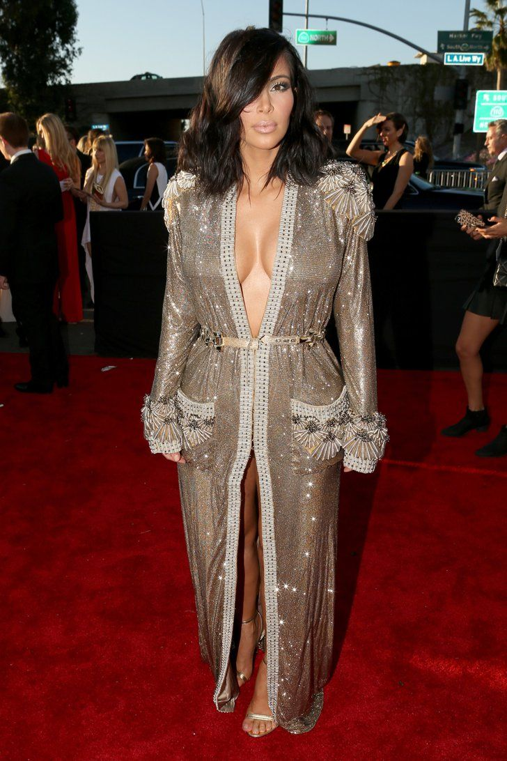 Pin for Later: The Hands-Down Sexiest Things Kim Kardashian Wore in 2015 Kim Wore a Gilded Jean Paul Gaultier Dress to the Grammys There was cleavage, there was sparkle, and she gave us reason to wear a robe out of the house.