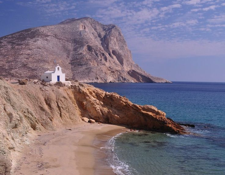 Little chapel over a secluded beach in Anafi, Greece