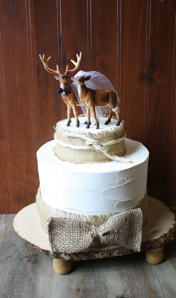 Deer wedding cake topperHunting wedding cake by MorganTheCreator, $48.00 I love the burlap and the idea of a funny or unusual topper... like animals :)