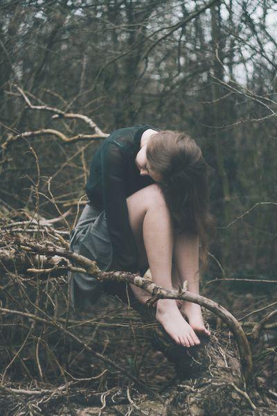 Girl in woods. Sad