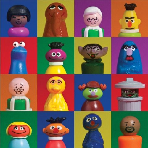 Back in the 70s, Fisher Price made a line of Sesame Street toys. The simplicity in them is a beautiful art. We have them