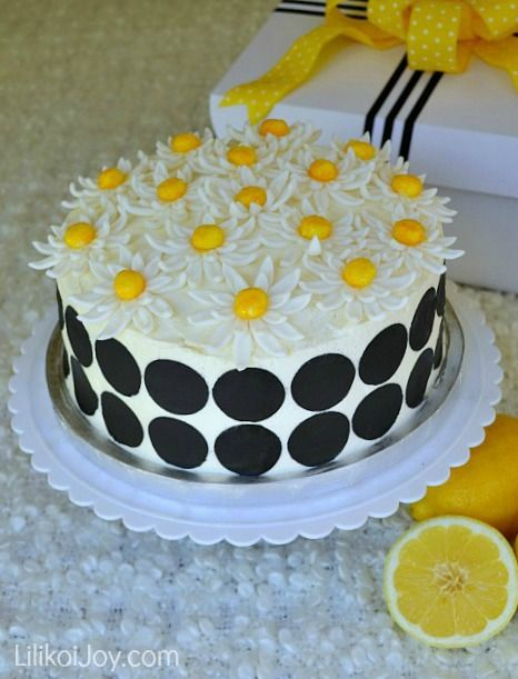 Cake Spade - Lemon Layer Cake recipe with lemon curd filling and a whipped mascarpone cream cheese frosting.