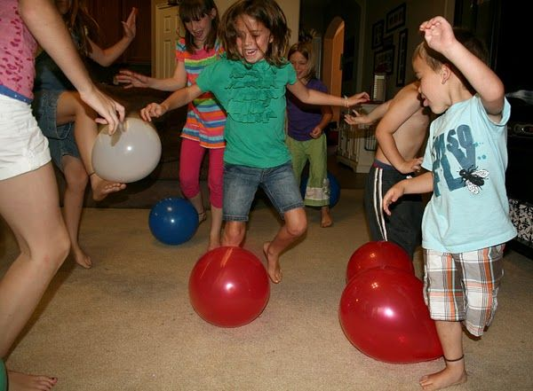 A recipe for fun or mayhem? All the kids tie balloons to their ankles with a rubber band, and the object is to pop the others' balloons without getting yours popped. This was so funny