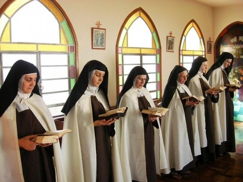Carmelite Nuns reciting the Liturgy of the Hours...
