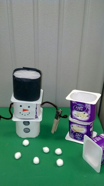 """Use yogurt cups for """"snowmen shoveling"""" The shovel ( clothespin) picks up the snowballs ( pom pom balls). The hat is removable to store the snowballs. Make a math game by writing numbers on cards. Pick the """"blizzard card"""" and dump your cup and start over!"""