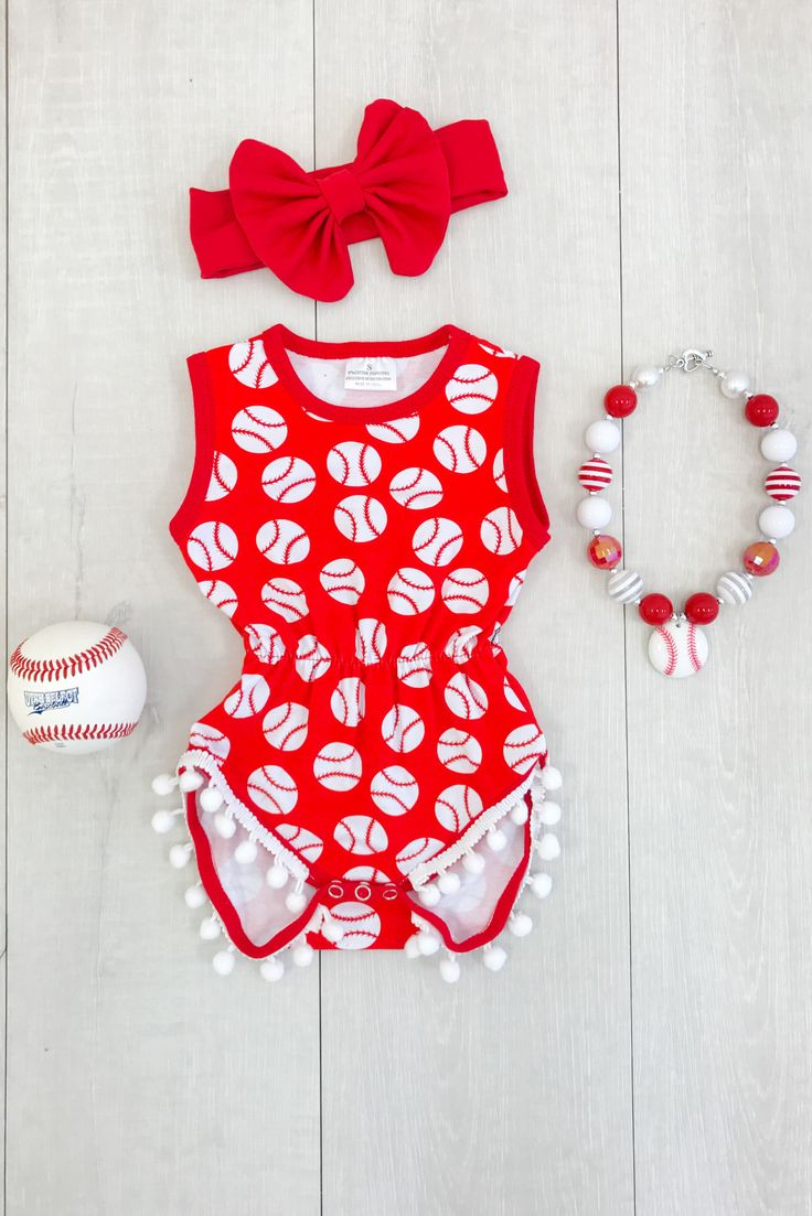 Red Baseball Pom Pom Romper from Sparkle in Pink Show off her style (and those chunky little thighs!) in our irresistibly adorable pom-pom rompers! Super soft fabric for extra comfort, with pom-pom lining at the bottom hem. These precious little rompers are an all in one ticket to perfection!