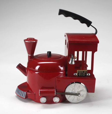 A fire engine tea kettle with moving wheels. From the auction of items that belonged to Michael Jackson, category - WTF items )))