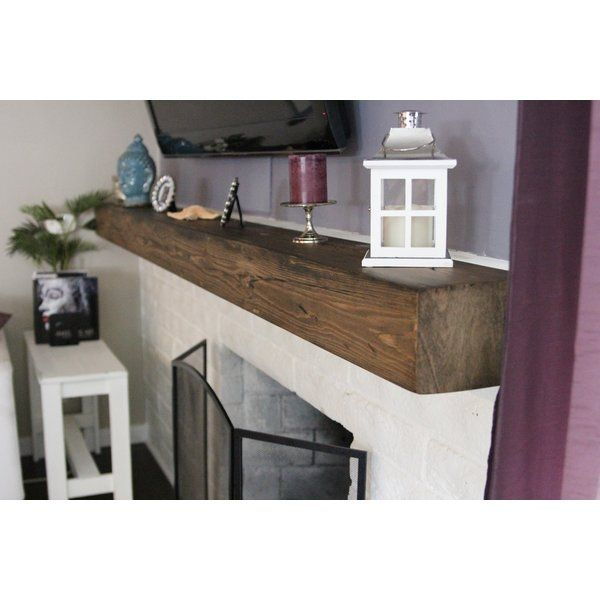 This is a custom built fireplace mantel. Made out of pine wood planks, this mantel is designed to look like a solid piece of log but without the heavy weight or heavy price tag! The mantel is hand and machined distressed to add that rustic feel. Constructed to the highest standards, there are no visible screw or nail holes and the design allows the mantel to float. With basic mechanical skills, the mantel is easy to install.