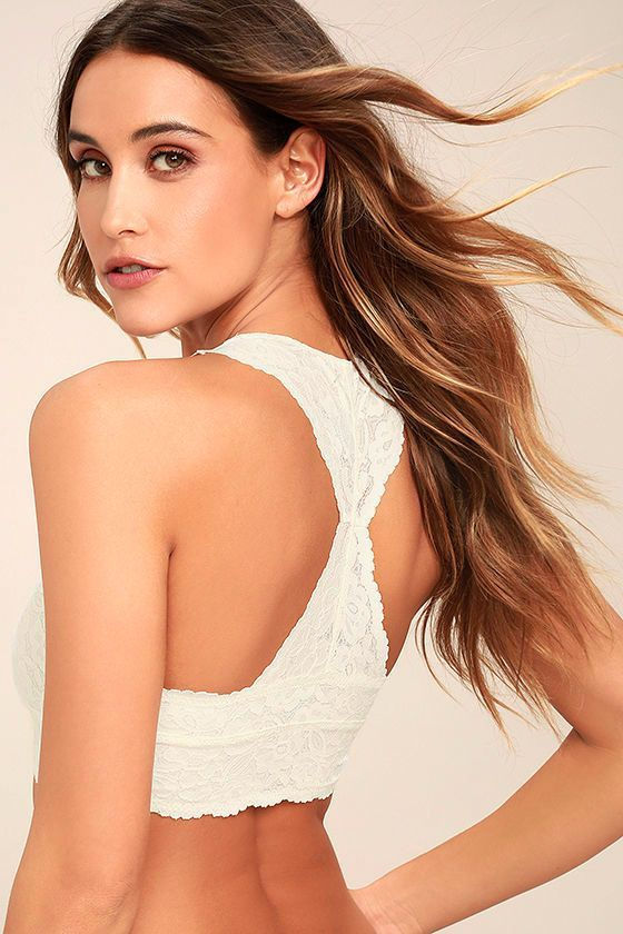 The Free People Galloon Racerback Cream Lace Bralette will make you feel like the sexiest girl in the world! Sheer lace shapes a plunging V-neckline and seamed cups. Racerback straps meet with an elastic bottom band.