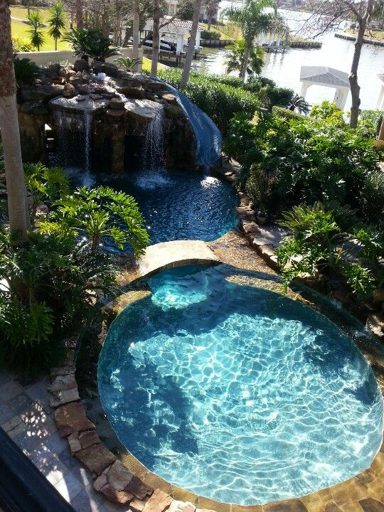 Pool, spa, slide, bridge and waterfall