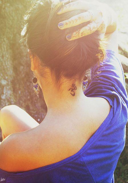 om symbol on back of female neck