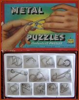 Metal Puzzles - I always got a set for Christmas or birthday, kept you quite for hours, sometimes you managed to get them apart by brute force.