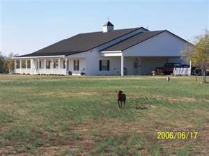 Love this house....This is the basic idea of what I want our future home to look like. Love metal pole barn homes :)