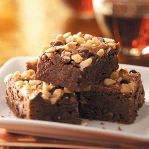 Super Brownies Recipe -Even though he's not a chocolate fan, my husband likes these brownies. I fix them for family, company and potlucks. Loaded with macadamia nuts, these chunky, bite-size treats never fail to catch attention on a buffet table. If you prefer, replace the macadamia nuts with pecans. —Bernice Muilenburg, Molalla, Oregon